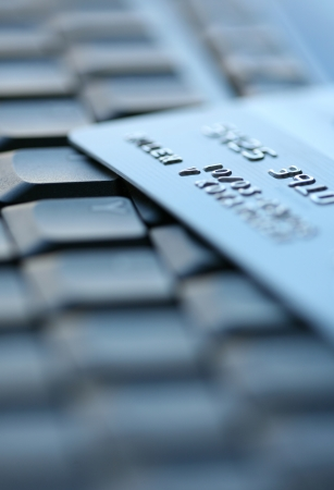 Bank Credit Card on a Computer Keyboard Stock Photo - 17979257