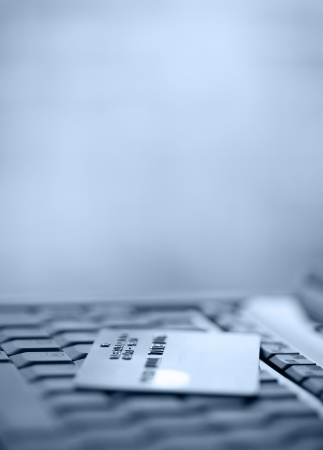 credit card debt: Bank Credit Card on a Computer Keyboard Stock Photo