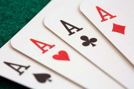 Close-up of four playing cards showing aces. Stok Fotoğraf