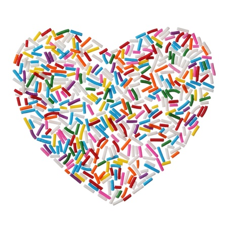 Colorful candy sprinkles heart isolated on white background photo