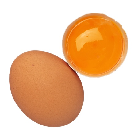 Whole egg and egg yolk in shell isolated on white Stock Photo