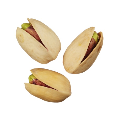 Pistachios nuts isolated on white background, close up Imagens