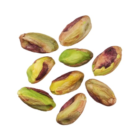 without people: Pistachios nuts without shells isolated on white background, close up