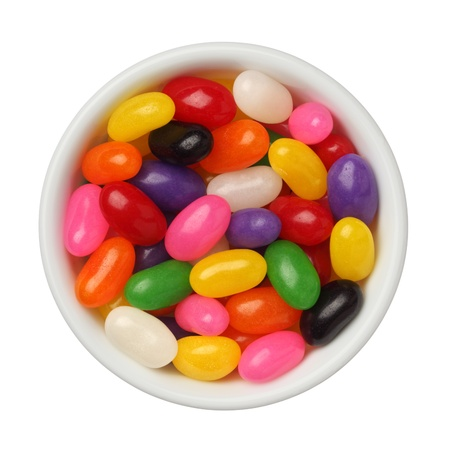 Jellybeans in a bowl isolated on white background, close up