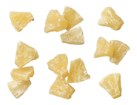 Dried pineapple pieces isolated on white background