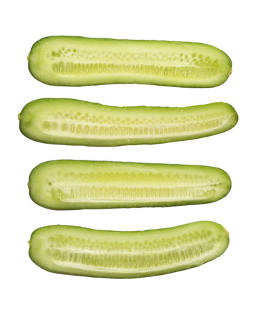 Fresh cut cucumber isolated on white background, close up photo
