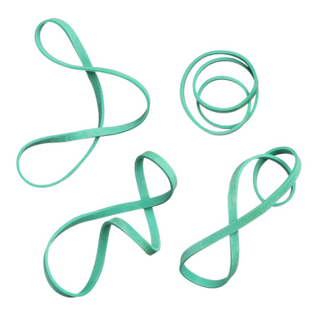 Twisted green elastic rubber bands isolated on white background photo