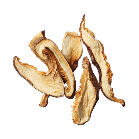 shiitake: Pile of dried shiitake mushroom slices isolated on white background