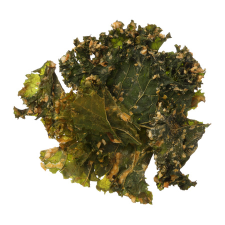 holistic view: Roasted kale chips isolated on white background Stock Photo