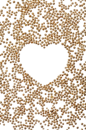 Uncooked quinoa heart frame on white Stock Photo