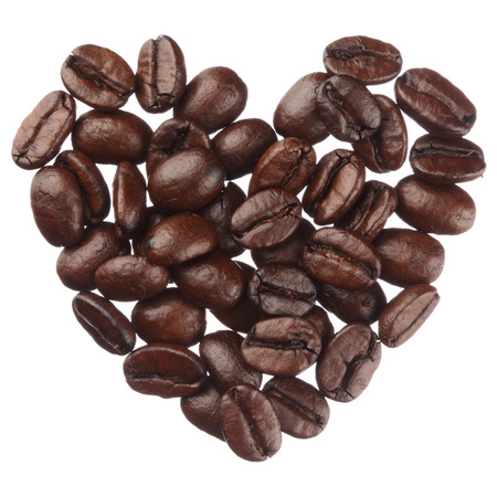 Coffee beans heart isolated on white background close up