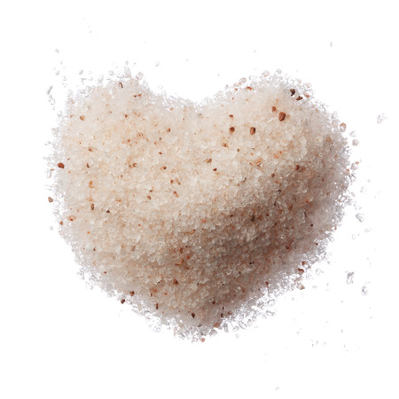 himalayan salt: Himalayan pink salt heart isolated on white top view