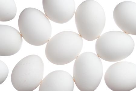 Many white eggs isolated on white background