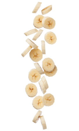 Falling banana slices isolated on white background, close up