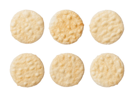 Rice crackers isolated on white background, close up Фото со стока
