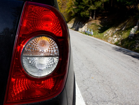 Rear car light with mountain background photo