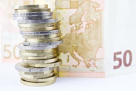 Stack of euro coins and bank photo