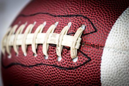 football tackle: American footbal ball close up Stock Photo