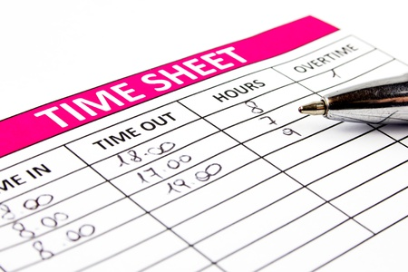 timekeeping: Filling Time Sheet with hours Stock Photo