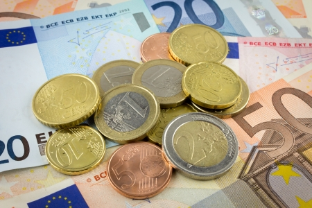 Euro banknote and coin photo