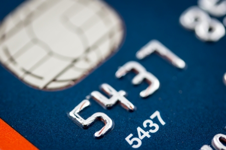 A close up of a credit card number and chip photo