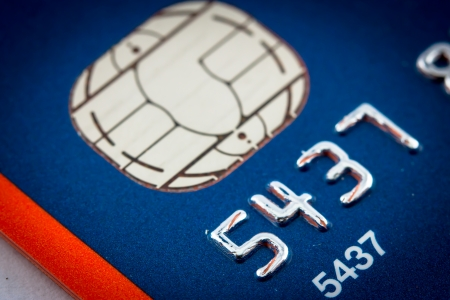 A close up of a credit card number and chip Stock Photo