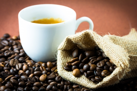 decaffeinated: Coffee beans in a jute bag and cup Stock Photo