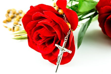 Rosary and rose on a white background Stock Photo