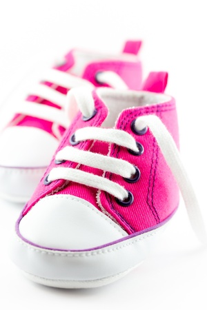 A pair of pink baby sneakers photo