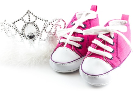 Tiara crown and baby shoes   Stock Photo