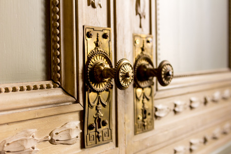Ancient style door handle - gold and wood photo