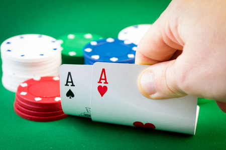 gamblers: Player looking down at a pocket pair of aces in Texas Hold Stock Photo