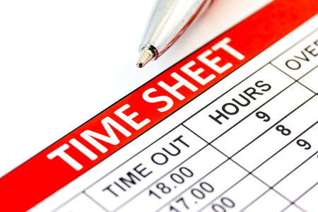 Compiled Time sheet with a pen - business concept Standard-Bild