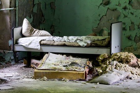 deteriorated: Abandoned bad in an old mental asylum