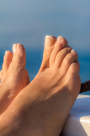 Feet on a boat - relaxing concept Stock Photo