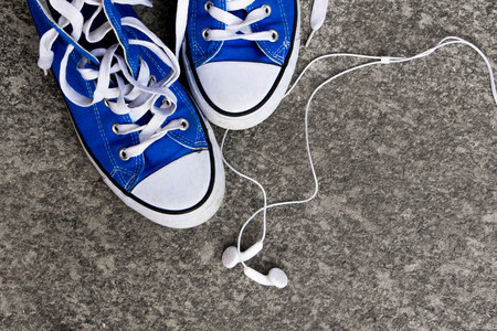 Sneakers and earphones - Adolescence concept Stock Photo