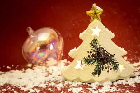 Christmas tree shape candle with a christmas ball