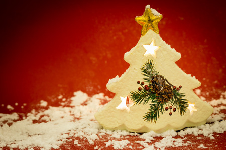 green house effect: Christmas tree shape candle with snow