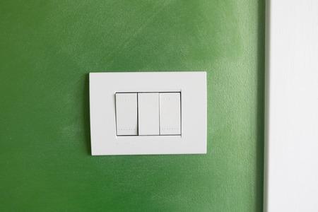 White light socket on a green background Stock Photo