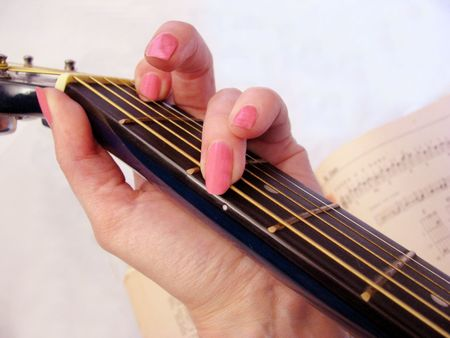 gitar: woman play guitar Stock Photo