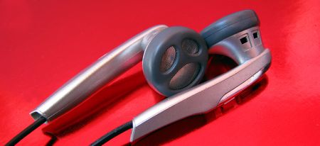 earphones on red background photo