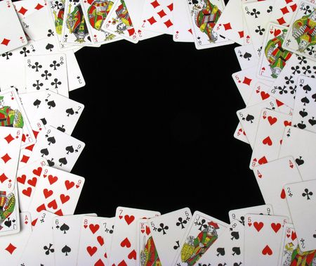 path to wealth: playing cards on black background