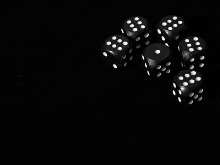 six dice on black photo