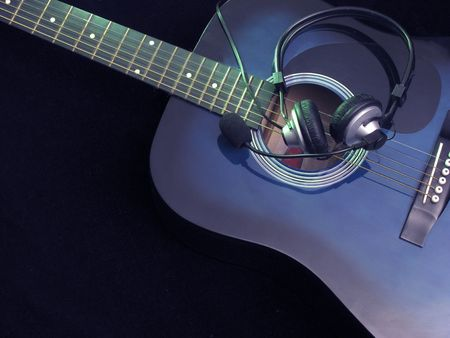 acoustic guitar and haedphones on black Stock Photo - 3863888