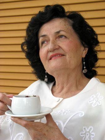 mature lady drinking coffee Stock Photo