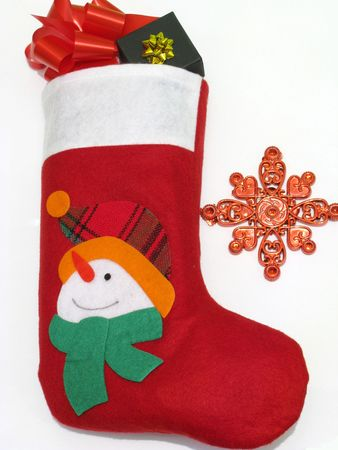 red christmas stocking with gifts in it photo