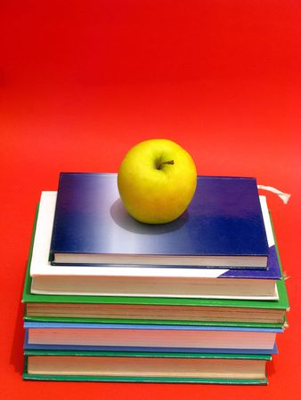 an apple on a stack of books next to a blank chalk board for copyspace Stock Photo - 4232050