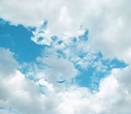 face of the young girl in the clouds Stock Photo - 5126812