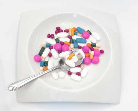 Pills in white plate on white background photo