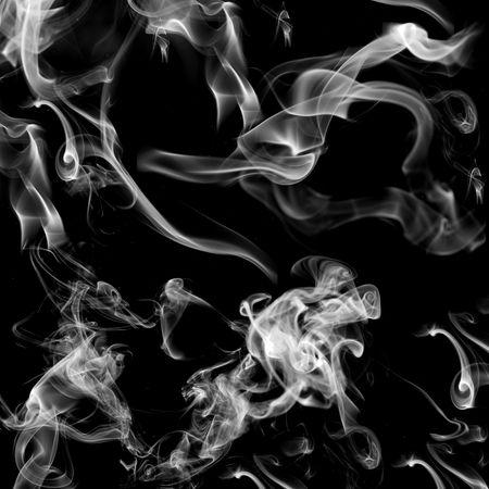 black background with smoke shapes inside photo